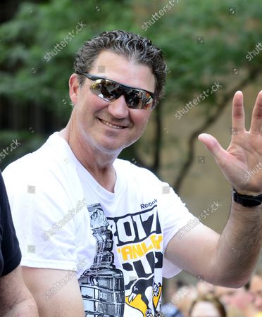 Pittsburgh Penguins Owner Mario Lemieux waves to the fans as part of the parade celebrating back to back Stanley Cup victories for his team in Pittsburgh on June 14, 2017.