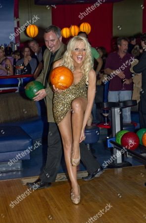 Editorial image of Michaele and Tereq Salahi promoting a bowling lane in Bethesda, Maryland, America  - 26 Oct 2010