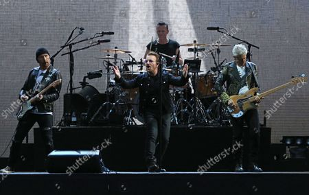 U2 members (From L to R) The Edge, Bono, Larry Mullen Jr and Adam Clayton perform in concert at the Stade de France near Paris on July 25, 2017.