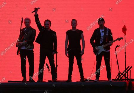 U2 members (From L to R) Adam Clayton, Bono, Larry Mullen Jr and The Edge perform in concert at the Stade de France near Paris on July 25, 2017.