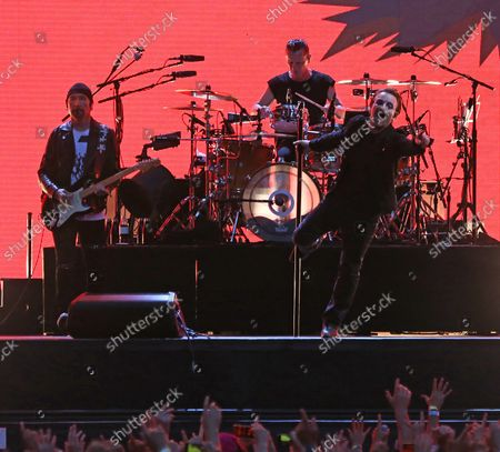U2 members The Edge (L), Larry Mullen Jr (C) and Bono perform in concert at the Stade de France near Paris on July 25, 2017.