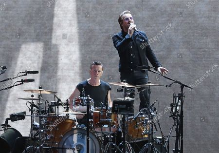 Larry Mullen Jr (L) and Bono of the band U2 perform in concert at the Stade de France near Paris on July 25, 2017.