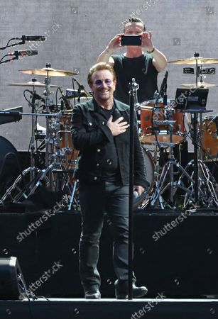 Bono (L) and Larry Mullen Jr of the band U2 perform in concert at the Stade de France near Paris on July 25, 2017.
