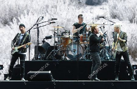 U2 members (From L to R) The Edge, Larry Mullen Jr, Bono and Adam Clayton perform in concert at the Stade de France near Paris on July 25, 2017.