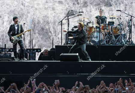 U2 members The Edge (L), Bono (C) and Larry Mullen Jr perform in concert at the Stade de France near Paris on July 25, 2017.