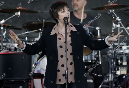 Stock Picture of Pat Benatar and Neil Giraldo perform at the 35th annual QuickChek New Jersey Festival of Ballooning in association with PNC Bank at Solberg Airport in Readington, NJ on July 29, 2017. The event is the largest summertime hot air balloon and music festival in North America.