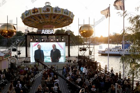 People watch the interview of ABBA members Bjoern Ulvaeus and Benny Andersson interview in London, which is streamed on a giant screen during the ABBA Voyage event at Grona Lund amusement park in Stockholm, Sweden, 02 September 2021. The band ABBA announced a new album.