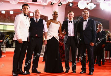 Oscar Isaac, from left, Paul Schrader, Tiffany Haddish, Tye Sheridan and Venice Film Festival director Alberto Barbera pose for photographers upon arrival at the premiere of the film 'The Card Counter' during the 78th edition of the Venice Film Festival in Venice, Italy