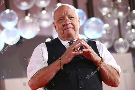 Paul Schrader poses for photographers upon arrival at the premiere of the film 'The Card Counter' during the 78th edition of the Venice Film Festival in Venice, Italy