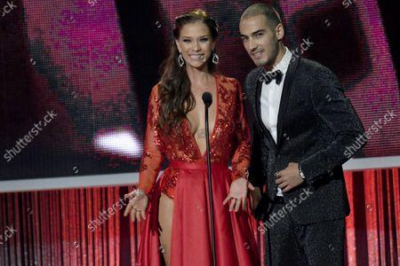 Carolina Miranda and Michel Duval appear on stage at the 2017 Telemundo Premios Tu Mundo  show at the American Airlines Arena in Miami, Florida,  August  24, 2017.