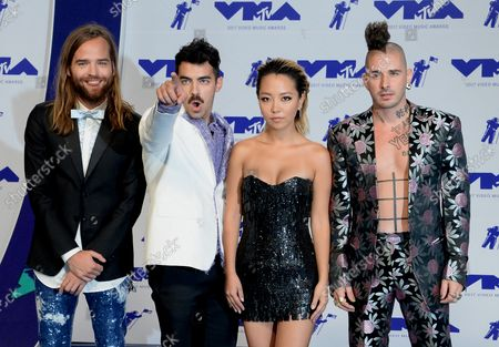 (L-R) Jack Lawless, Joe Jonas, JinJoo Lee and Cole Whittle of DNCE arrive for the 34th annual MTV Video Music Awards at The Forum in Inglewood, California on August 27, 2017.