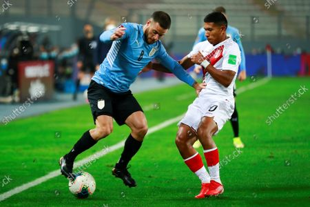 Peru's Edison Flores (R) in action against Uruguay's Nahitan Nandez (L) during the Conmebol qualifiers for the Qatar 2022 World Cup between Peru and Uruguay at the National Stadium in Lima, Peru, 02 September 2021.