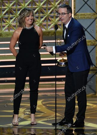 John Oliver is accompanied by executive producer Liz Stanton as he accepts the award for Outstanding Variety Talk Series for 'Last Week Tonight With John Oliver' onstage during the 69th annual Primetime Emmy Awards at Microsoft Theater in Los Angeles on September 17, 2017.
