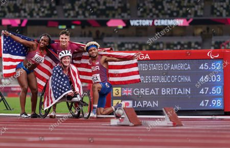 Brittni Mason USA, Tatyana Mcfadden USA, Nick Mayhugh USA, and Noah Malone USA celebrate winning the 4 x 100m Universal Relay Final at the Olympic Stadium. Tokyo 2020 Paralympic Games, Tokyo, Japan, Friday 03 September 2021.