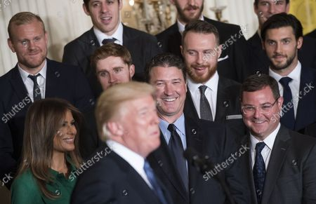 Pittsburgh Penguins co-owner Mario Lemieux, joined by members of the team, laughs as President Donald Trump delivers remarks as he welcomes the 2017 Stanley Cup Champion Pittsburgh Penguins to the White House, on October 10, 2017 in Washington, D.C.