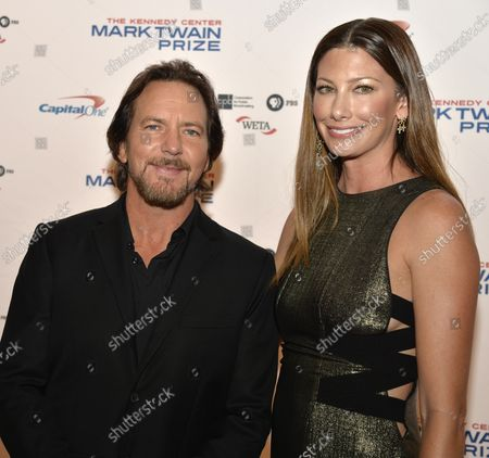 Eddie Vedder (L), member of the rock group Pearl Jam arrives with his wife Jill McCormick at the John F. Kennedy Center for the Performing Arts for a gala for the Mark Twain Prize for American Humor at the Kennedy Center, October 22, 2017, in Washington, DC. This year's recipient is late night host and comedian David Letterman.