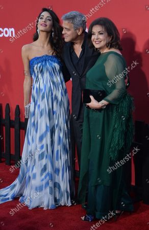 """Executive producer/writer/director George Clooney, his wife, human rights attorney Amal Clooney and her mother Baria Alamuddin attend the premiere of the motion picture crime thriller """"Suburbicon"""" at the Regency Village Theatre in the Westwood section of Los Angeles on October 22, 2017. Storyline: Suburbicon is a peaceful, idyllic suburban community with affordable homes and manicured lawnsÉthe perfect place to raise a family, and in the summer of 1959, the Lodge family is doing just that. But the tranquil surface masks a disturbing reality, as husband and father Gardner Lodge (Matt.Damon) must navigate the townÕs dark underbelly of betrayal, deceit, and violence. This is a tale of.very flawed people making very bad choices. This is Suburbicon."""