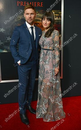 Scott Haze (L) and Erin Darke arrive for the premiere of 'Thank You for Your Service' at the Regal L.A. LIVE in Los Angeles on October 23, 2017.