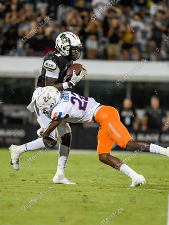 Stock Picture of Orlando, FL, U.S: UCF Knights wide receiver Brandon Johnson (3) is tackled by Boise State Broncos cornerback Tyric LeBeauf (22) after a catch during NCAA football game between Boise State Broncos and the UCF Knights. UCF defeated Boise State 36-31 at Bounce House in Orlando, Fl