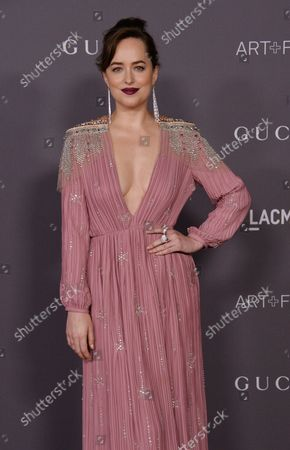 Actress Dakota Johnson attends the seventh annual LACMA Art+Film gala honoring artist Mark Bradford and filmmaker George Lucas at the Los Angeles County Museum of Art in Los Angeles on November 4, 2017.