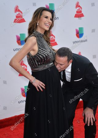 Cristina Bernal (L) and Alan Tacher arrive on the red carpet for the 18th annual Latin Grammy Awards at the MGM Garden Arena in Las Vegas, Nevada on November 16, 2017.