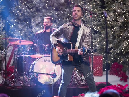 Nick Fradiani performs at the 86th annual Hollywood Christmas Parade in Los Angeles on November 26, 2017.