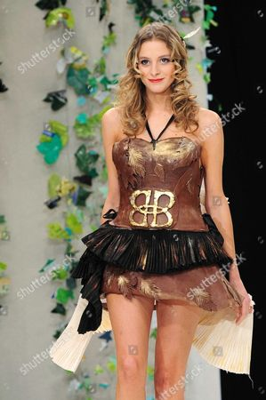 Stock Photo of Nubia Esteban displays a chocolate decorated dress, a creation by Julhes Paris (French famous delicatessen in Paris)