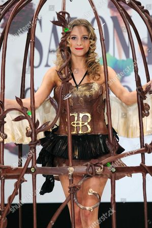 Stock Image of Nubia Esteban displays a chocolate decorated dress, a creation by Julhes Paris (French famous delicatessen in Paris)