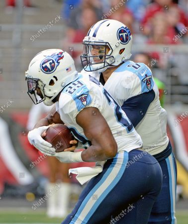 Stock Image of Tennessee Titans' quarterback Marcus Mariota (R) fakes a hand off to DeMarco Murray in the first quarter against the Arizona Cardinals at University of Phoenix Stadium in Glendale, Arizona December 10, 2017.
