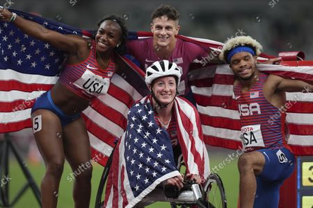 Top, from left to right, Brittni mason, Nick Mayhugh, Noah Malone and Tatyana McFadden, bottom, of the United States celebrate after winning the 4x100m universal relay at Tokyo 2020 Paralympic Games, in Tokyo, Japan