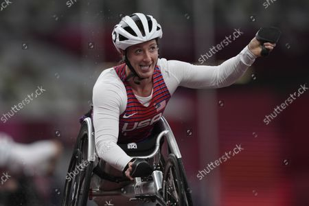 United States' Tatyana McFadden celebrates after winning the 4x100m universal relay at Tokyo 2020 Paralympic Games, in Tokyo, Japan