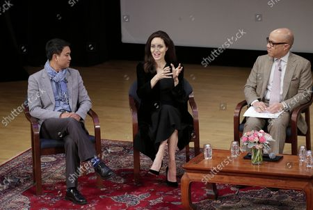 Phloeun Prim, Angelina Jolie, and Darren Walker participate in an Asia Society discussion on 'Memory, Resilience and Renewal in Cambodia' - 'Light after Darkness: Memory, Resilience and Renewal in Cambodia' in New York City on December 14, 2017. The Asia Society discussion with Angelina Jolie, director Rithy Panh, Cambodian Living Arts Executive Director Phloeun Prim, and author Loung Ung addresses the role that art and storytelling have played in Cambodia's process of reconciliation and recovery.