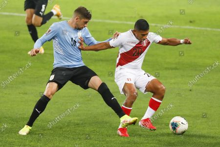 Federico Valverde and Edison Flores during the 2022 Football World Cup Qualifier between Peru adn Uruguay at the Estádio Nacional del Peru in Lima, Peru. The game ended 1-1 with Tapia scoring for the hosts in the 24th minute and de Arrascaeta equalizing for Uruguay in the 29th.