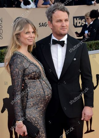 Jason Clarke (R) and Cecile Breccia arrive for the the 24th annual SAG Awards held at the Shrine Auditorium in Los Angeles on January 21, 2018. The Screen Actors Guild Awards will be broadcast live on TNT and TBS.
