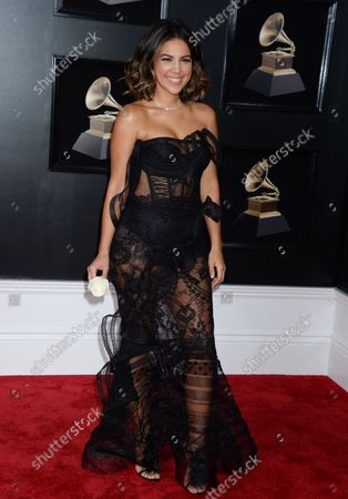 Liz Hernandez arrives on the red carpet at the 60th Annual Grammy Awards ceremony at Madison Square Garden in New York City on January 28, 2018. The CBS network will broadcast the show live from Madison Square Garden in New York City. It will be the first time since 2003 that the ceremony will not be held in Los Angeles.