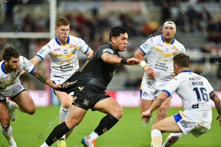 Hull FC's Andre Savelio takes on Leeds Rhinos' Richie Myler