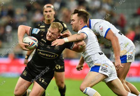 Hull FC's Jordan Johnstone tackled by Leeds Rhinos' Richie Myler and Matt Prior