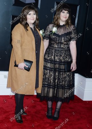Laura Rogers and Lydia Slagle arrive on the red carpet at the 60th Annual Grammy Awards ceremony at Madison Square Garden in New York City on January 28, 2018. The CBS network will broadcast the show live from Madison Square Garden in New York City. It will be the first time since 2003 that the ceremony will not be held in Los Angeles.