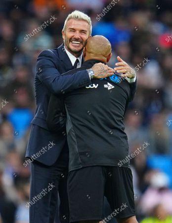 David Beckham with Roberto Carlos of the World Eleven