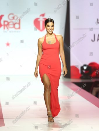 Stock Image of Liz Hernandez walks on the runway at the American Heart Association's Go Red For Women Red Dress Collection 2018 presented by Macy's at the Hammerstein Ballroom on February 8, 2018 in New York City.