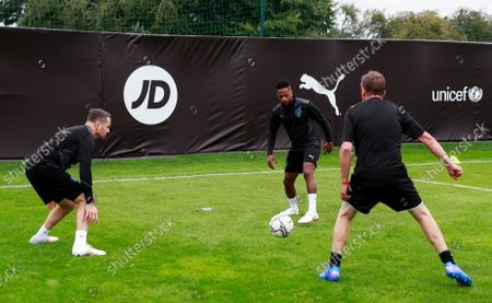 Shay Given of World XI, Patrice Evra of World XI and Lee Mack of World XI during a training session