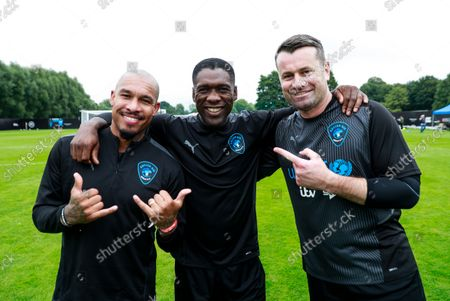 Stock Photo of Nigel De Jong of World XI, Clarence Seedorf of World XI and Shay Given of World XI during a training session
