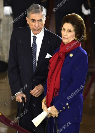 Former Senator and Governor Chuck Robb and his wife Lynda Bird Johnson Robb, daughter of President Lyndon B. Johnson, await the start of a ceremony to honor the late Rev. Billy Graham, in the US Capitol rotunda, February 28, 2018, in Washington, DC. The Baptist evangelist, 99, was an informal advisor to presidents since President Harry Truman and is the first religious leader to lay in honor at the Capitol.