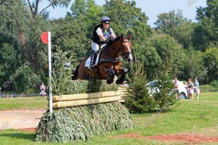Pippa Funnell riding Majas Hope clears The EHOA Dewpond fence 5B,; Bicton Park, East Budleigh Salterton, Budleigh Salterton, United Kingdom: Bicton CCI 5* Equestrian Event.