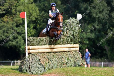 Pippa Funnell riding Majas Hope clears The EHOA Dewpond fence 5a,; Bicton Park, East Budleigh Salterton, Budleigh Salterton, United Kingdom: Bicton CCI 5* Equestrian Event.