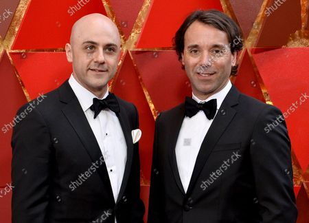 Stock Picture of Sound effect editors Nathan Robitaille and Nelson Ferreira arrive on the red carpet for the 90th annual Academy Awards at the Dolby Theatre in the Hollywood section of Los Angeles on March 4, 2018.