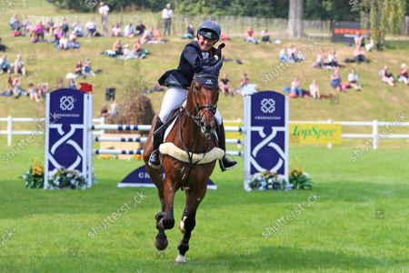 Stock Picture of Pippa Funnell riding Billy Walk On celebrates a clear round and second place; Bicton Park, East Budleigh Salterton, Budleigh Salterton, United Kingdom: Bicton CCI 5* Equestrian Event.