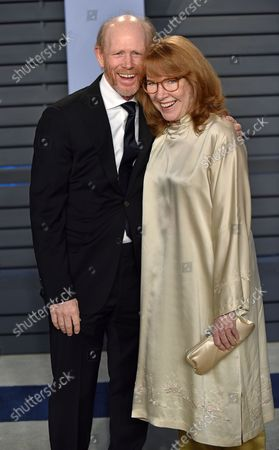 Ron Howard (L) and his wife Cheryl Howard arrive for the Vanity Fair Oscar Party at the Wallis Annenberg Center for the Performing Arts in Beverly Hills, California on March 4, 2018.