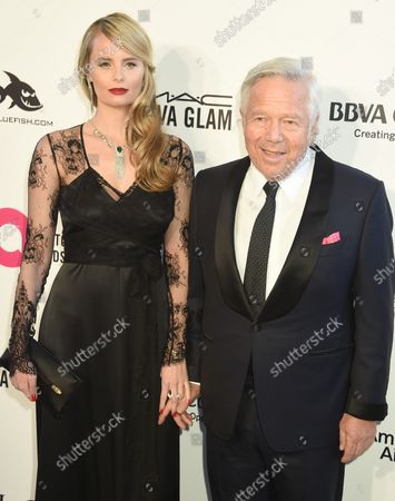 Ricki Lander (L) and Robert Kraft arrive for the Elton John Aids Foundation's 26th annual Academy Awards Viewing party at West Hollywood Park in Los Angeles on March 4, 2018.
