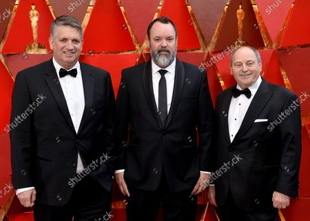 L-R) Christian Cooke, Brad Zoern, and Glen Gauthier arrive on the red carpet for the 90th annual Academy Awards at the Dolby Theatre in the Hollywood section of Los Angeles on March 4, 2018.